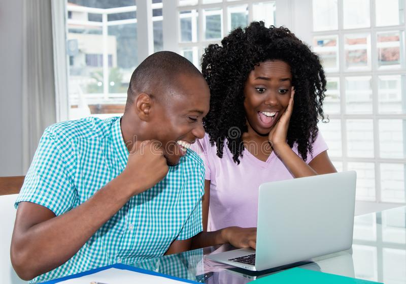 African american couple shopping presents and gifts online with royalty free stock photography