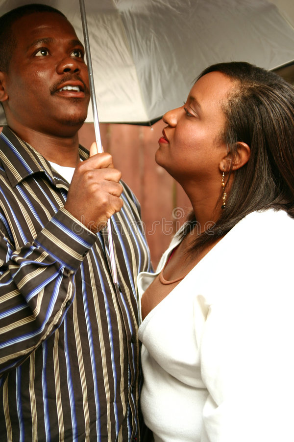 Download African American Couple Under Umbrella Stock Photo - Image of family, partners: 3803902