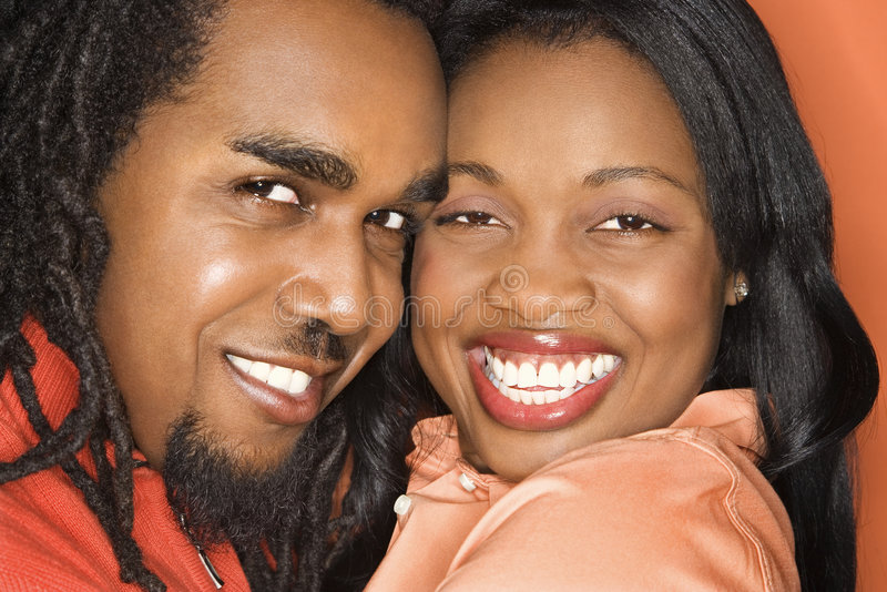 African-American couple wearing orange clothing. stock image