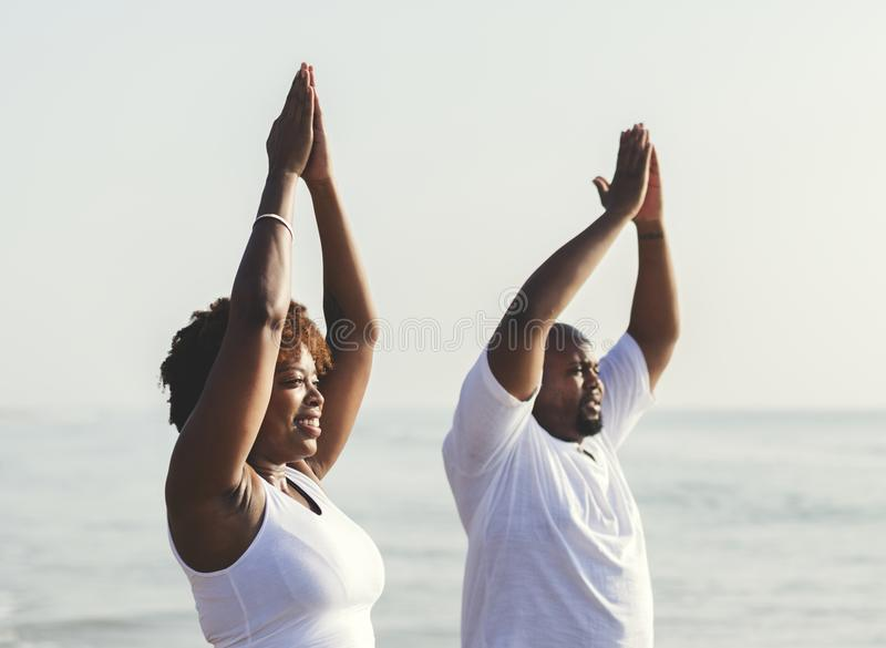 African American couple working out at the beach stock image