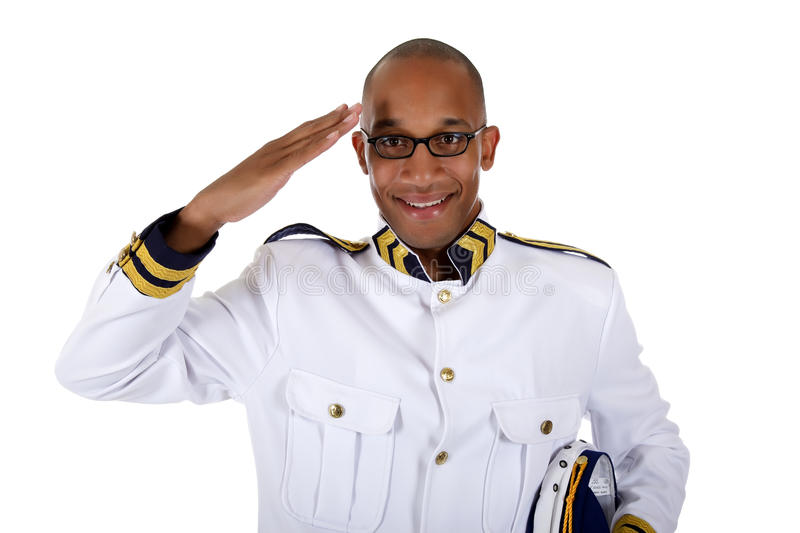 African American cruise ship steward, salute. Attractive African American young male cruise ship steward gives salute . Studio shot. White background royalty free stock photos