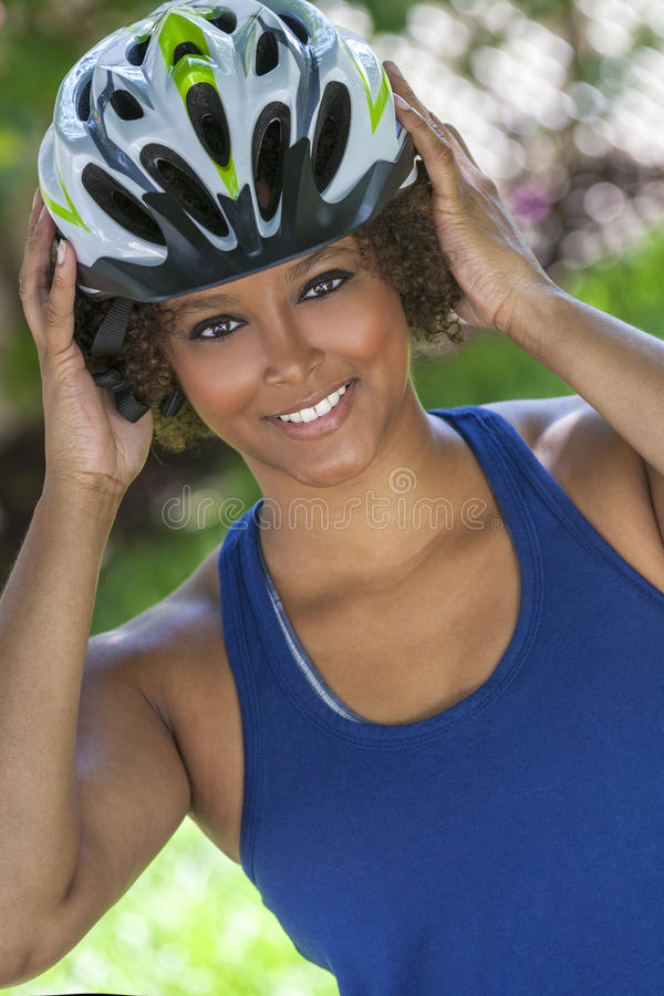 African American Woman Wearing Bicycle Helmet royalty free stock photography