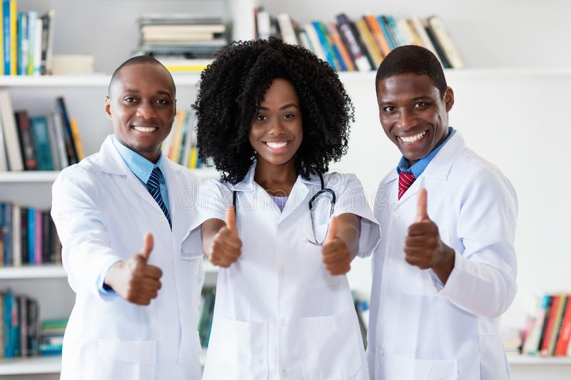 African american doctor and general practitioner and nurse as medical team royalty free stock photos