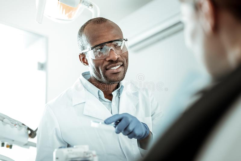 African American doctor making sure his female patient understanding royalty free stock photo