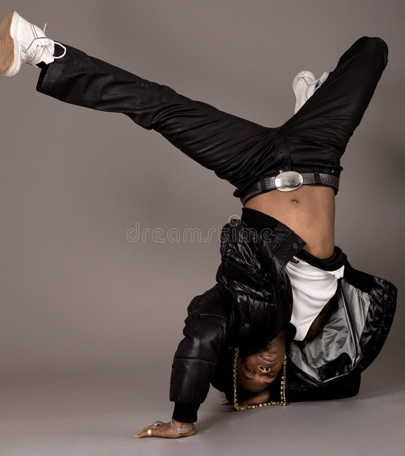 African american doing break dance. On grey background stock photos