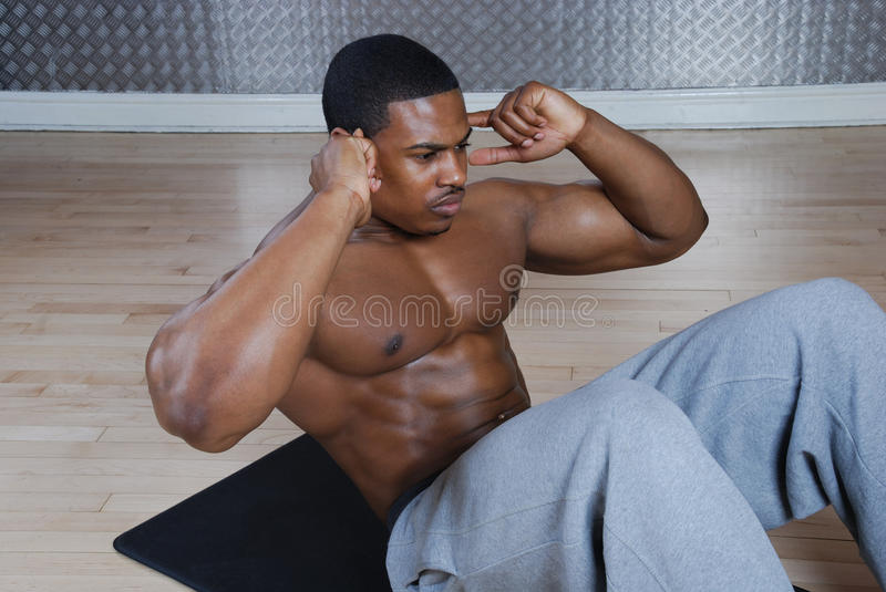 African american doing sit ups and crunches royalty free stock photos