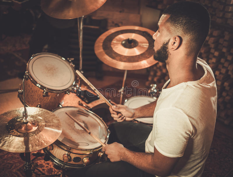 African american drummer in boutique recording studio.  stock image