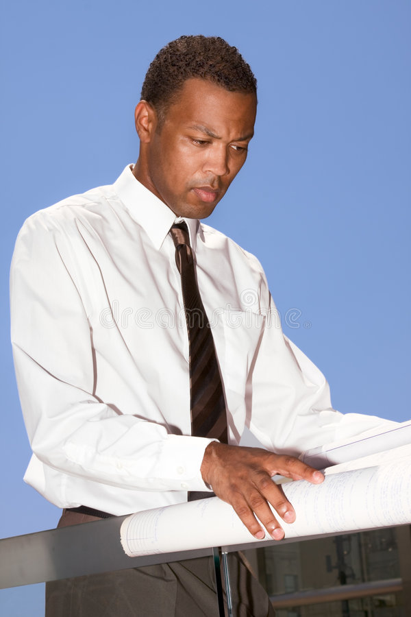 Download African American Engineer Examining Blue Print Stock Photo - Image: 6465692