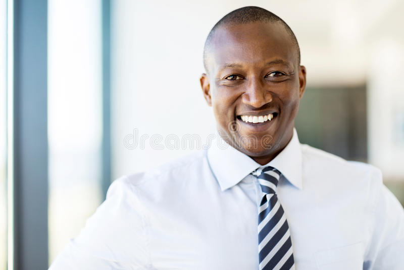 African american entrepreneur. Cheerful african american entrepreneur in modern office stock photos