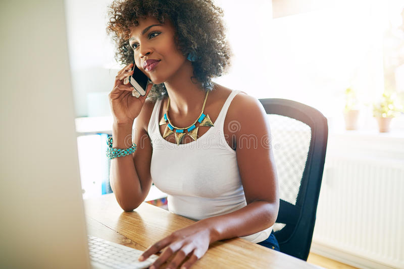 African American entrepreneur talking on a mobile royalty free stock photography