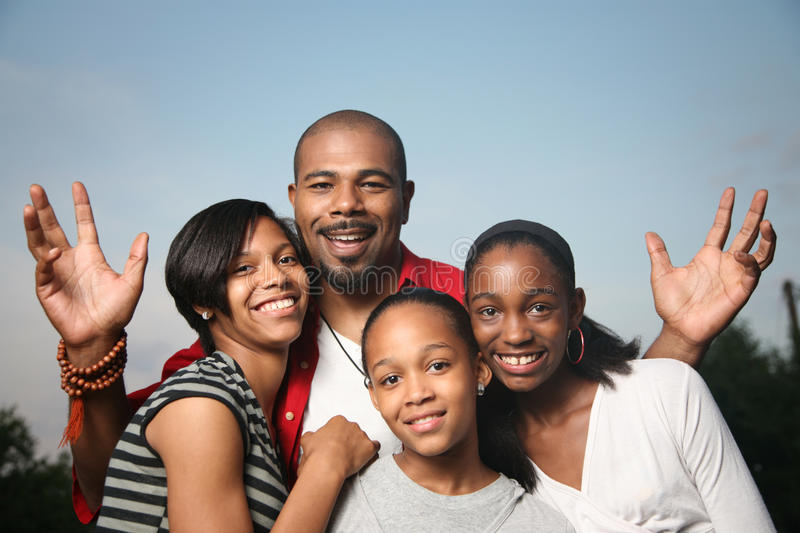 African American family. Happy African American family. Father with teenage daughters