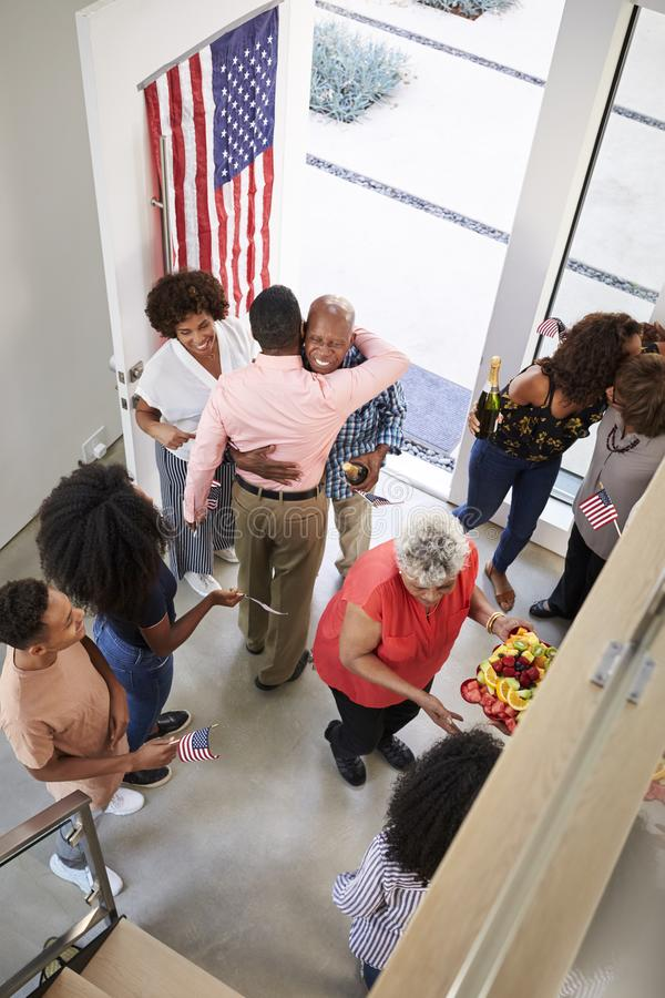 African American  family arriving for an Independence Day house party with relatives,elevated view, vertical stock image