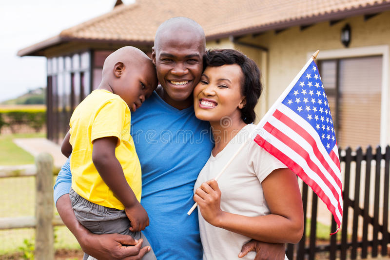 African american family. Beautiful african american family holding usa flag stock photo