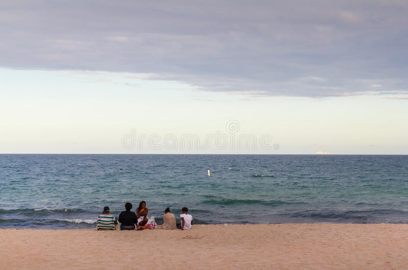 African-American family enjoying a picnic at the beach royalty free stock image