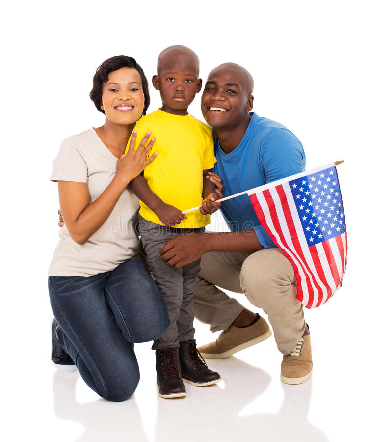 African american family flag. Adorable african american family of three with usa flag stock photo