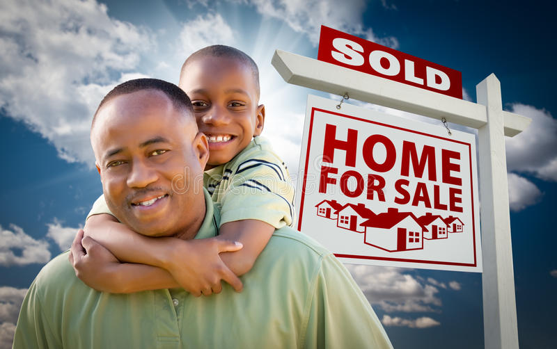 Download African American Family In Front Of Sold Home Sign Stock Photo - Image: 17897282
