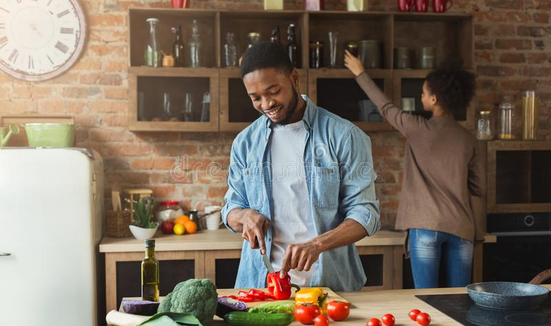 African-american family cooking in loft kitchen. African-american family at kitchen. Black couple cooking in loft interior stock photo
