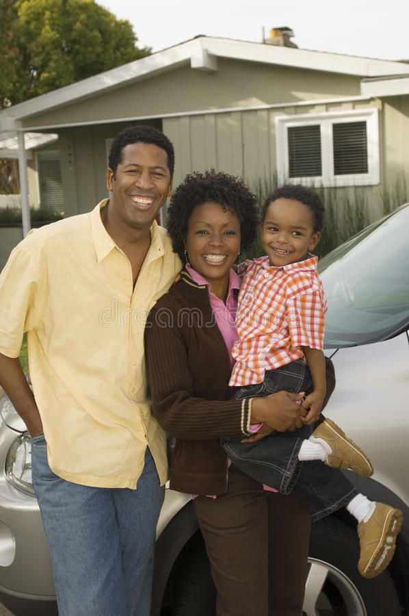 African American Family Standing By Car Royalty Free Stock Photos