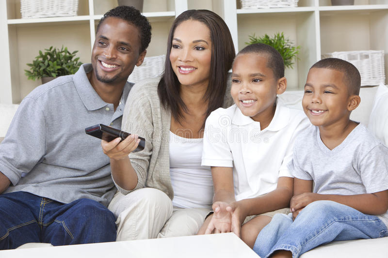 African American Family Watching Television stock photo