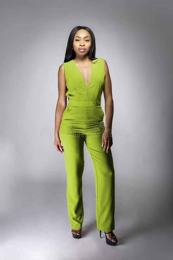 African American Fashion Model Wearing a Lime Green Jumpsuit royalty free stock image