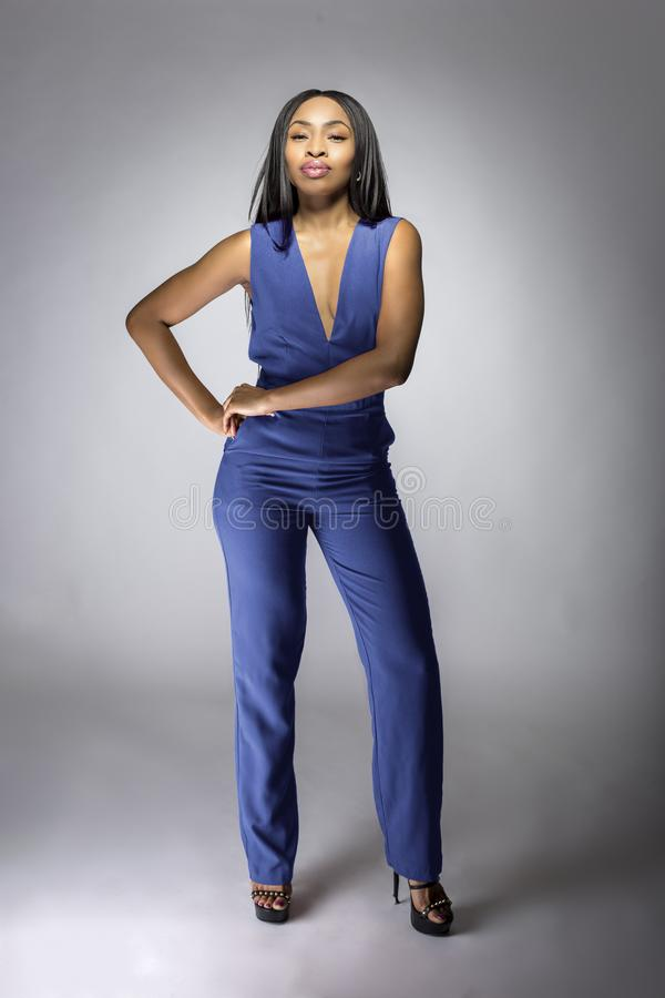 African American Fashion Model Wearing a Blue Jumpsuit stock images