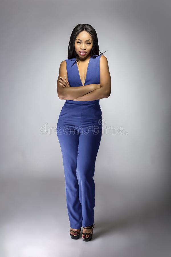 African American Fashion Model Wearing a Blue Jumpsuit stock photos
