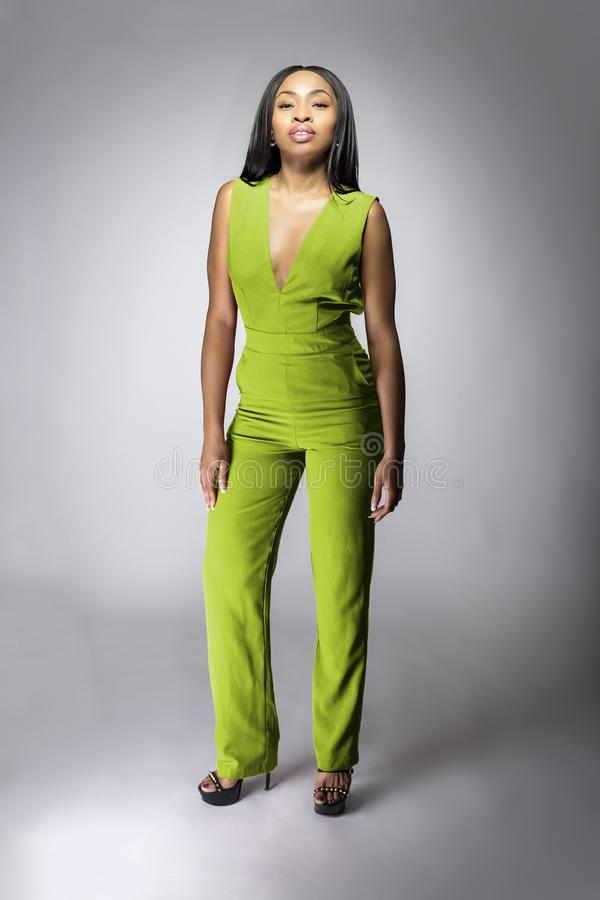 African American Fashion Model Wearing a Lime Green Jumpsuit royalty free stock photos