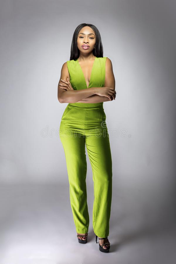 African American Fashion Model Wearing a Lime Green Jumpsuit stock photos