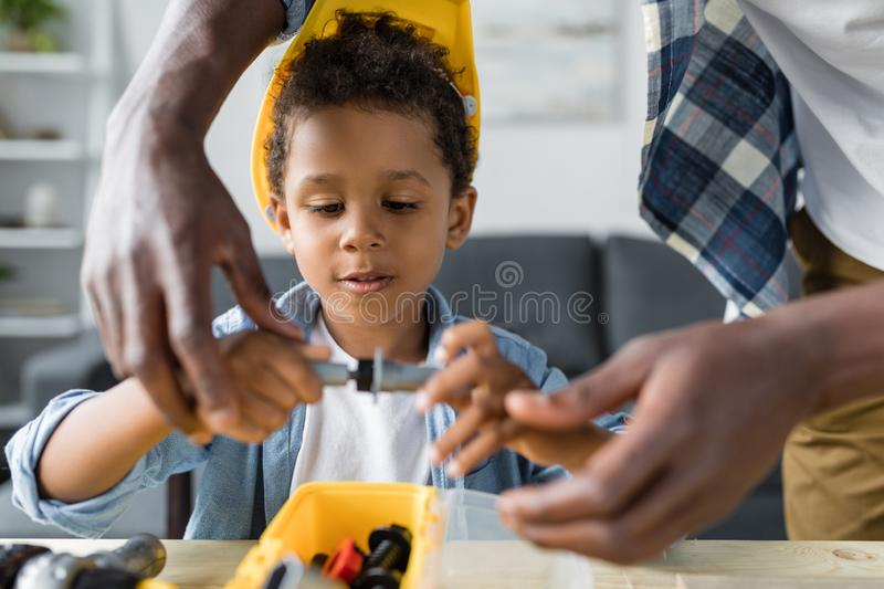 african-american father and adorable little son playing stock images