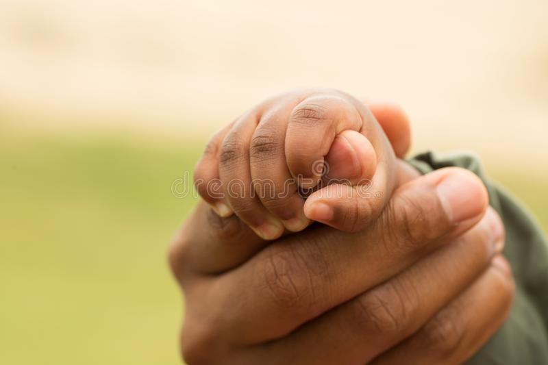 African American father holding his daughters hands. royalty free stock photo