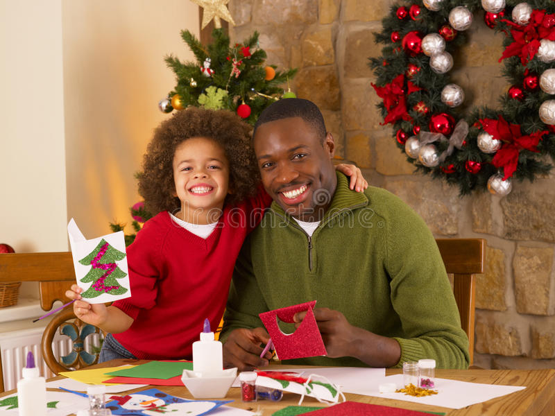 African American father and mixed race son stock images