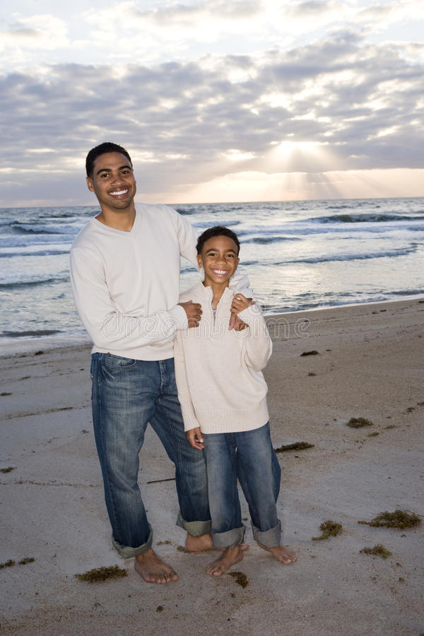African-American Father And Son On Beach Stock Photos