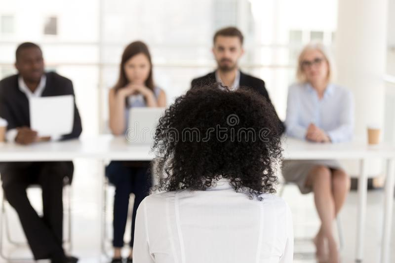 African American female applicant at job interview rear view royalty free stock image