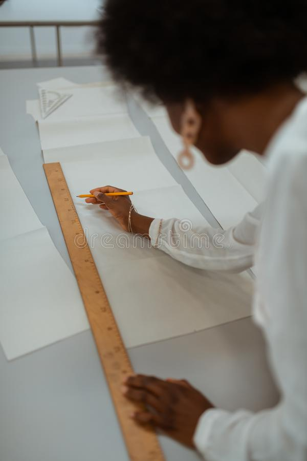 African American female designer creating a sewing pattern stock image