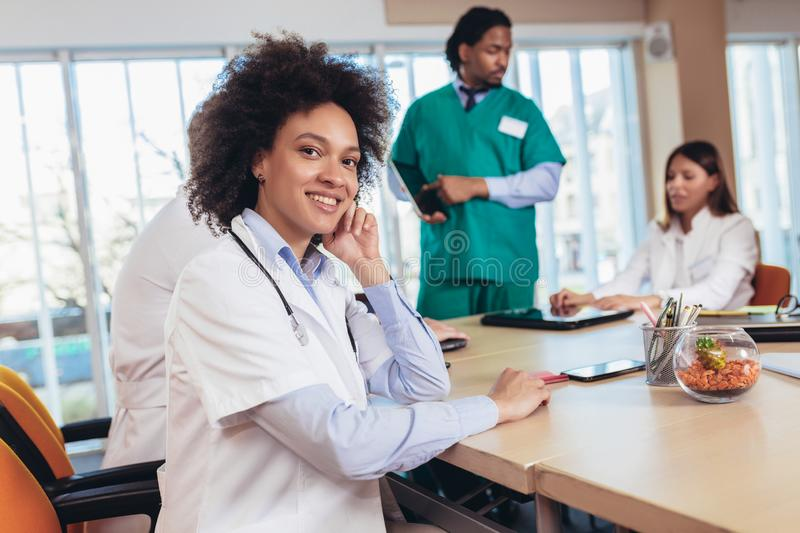 African american female doctor on hospital looking at camera smiling stock image
