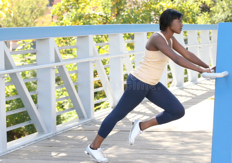 African-American Female Exercising, Stretching stock photos