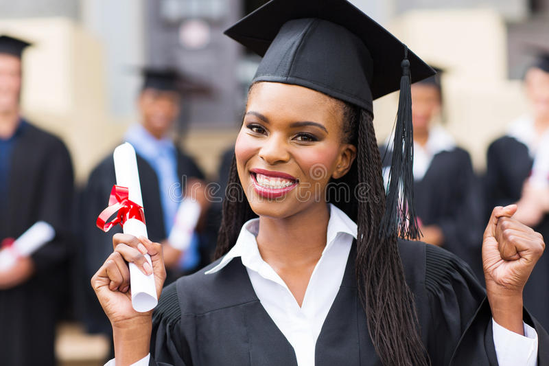 African american female graduate. Happy african american female graduate at university graduation ceremony royalty free stock photos