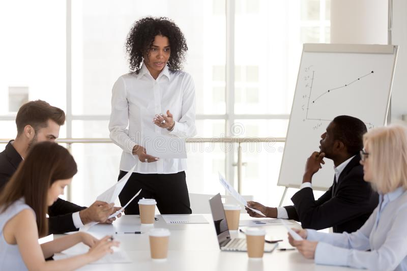 African-american female manager presenting report speaking at di stock photography