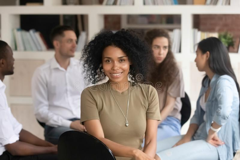 African american female psychotherapist looking at camera during group therapy. African american female psychologist psychotherapist looking at camera during royalty free stock image