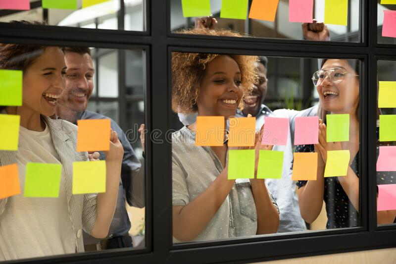 Excited multiethnic team celebrate successful project complete stock photography