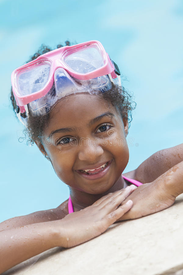 African American Girl Child Swimming Pool Wearing Goggles royalty free stock photography