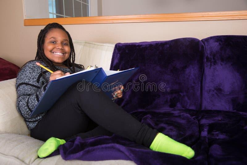 African American girl doing homework stock photography