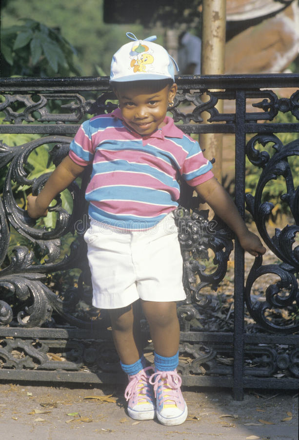 An African-American girl dressed for summer, Savannah, GA stock photo