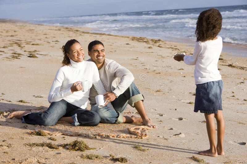 African-American girl with parents on beach royalty free stock photos