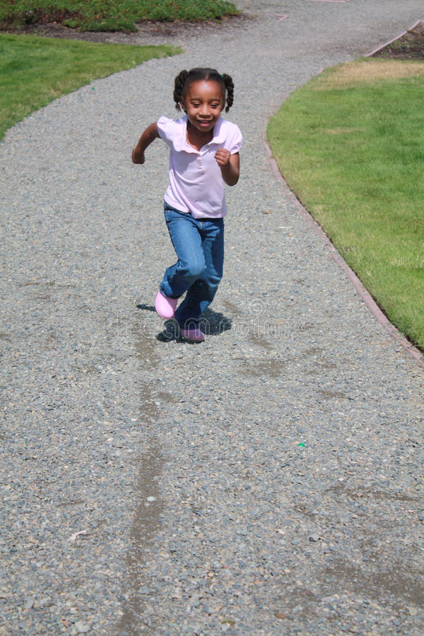 African American Girl running stock images