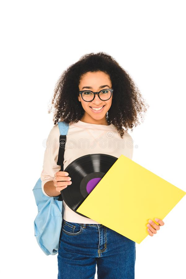 African american girl standing in glasses with vinyl record isolated. On white royalty free stock image