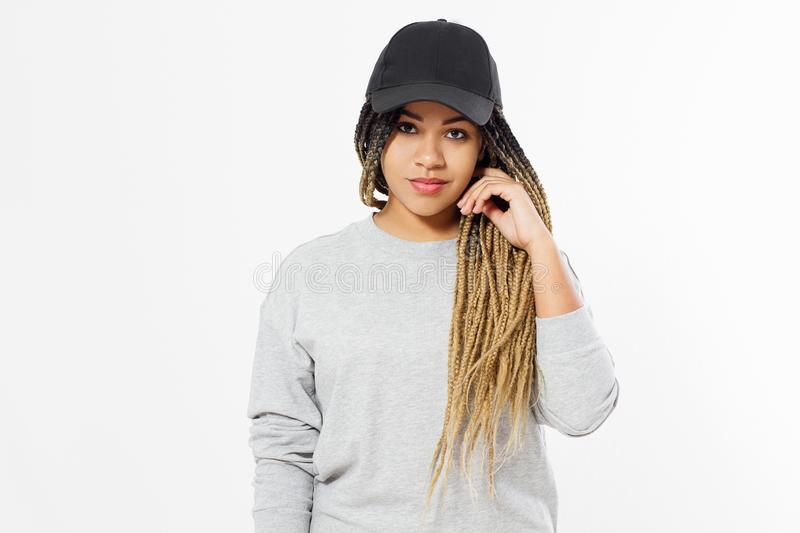 African american girl in template blank sweatshirt and cap isolated on white background. Front pullover and hat view. Copy space. And mock up. Place for stock image