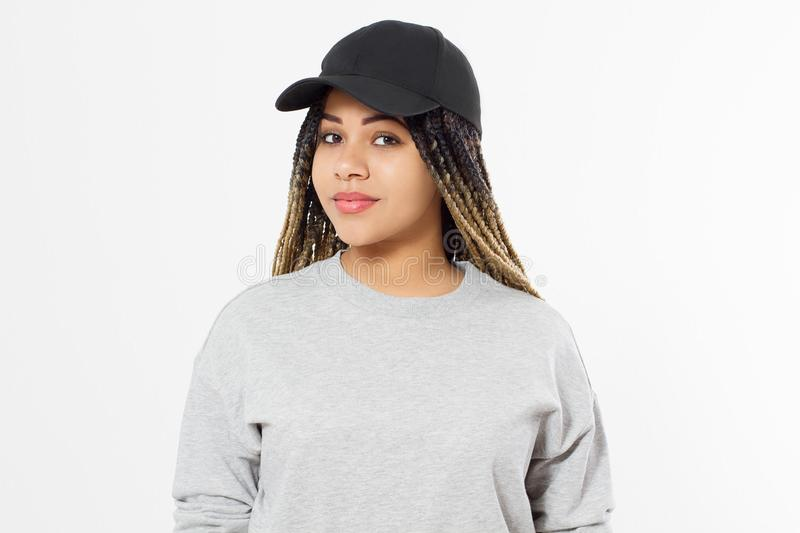 African american girl in template blank sweatshirt and cap isolated on white background. Front pullover and hat view. Copy space. And mock up. Place for stock images
