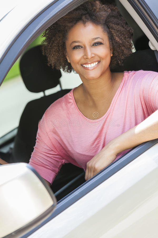 African American Girl Young Woman Driving Car stock images