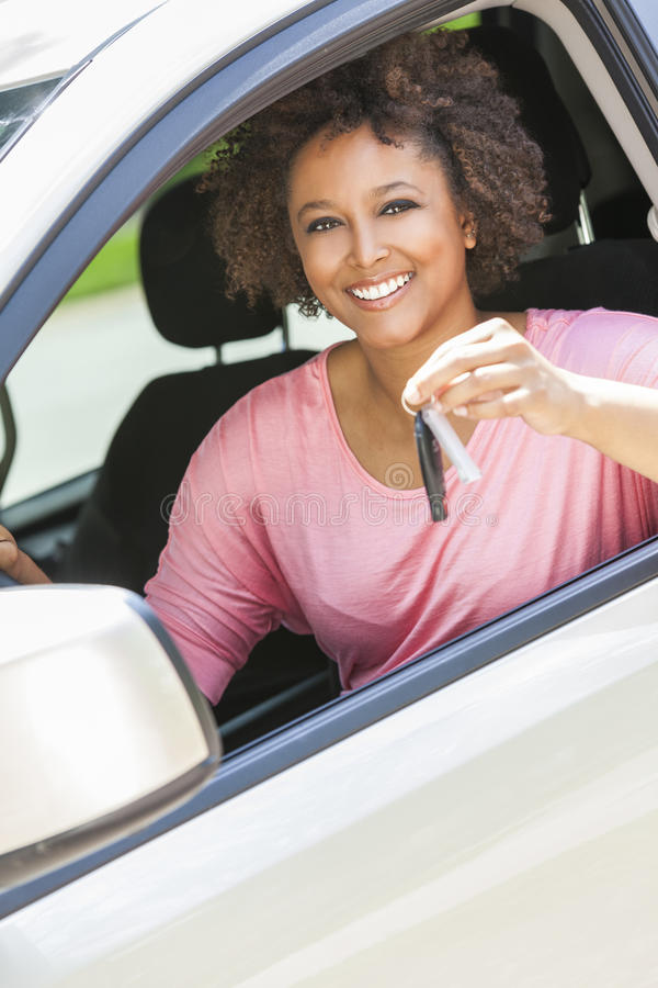 African American Girl Young Woman Driving Car Holding Key royalty free stock photo